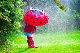 little_girl_with_umbrella_playing_in_the_rain_cg9p4461512c_th